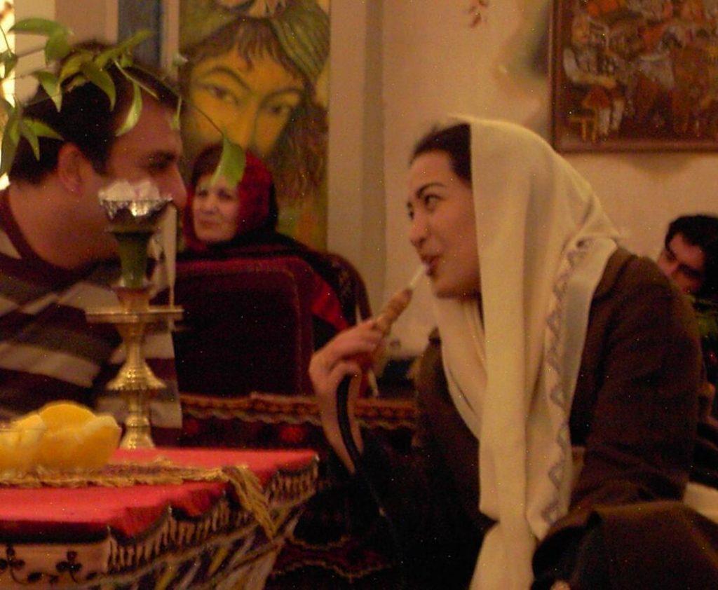 Iran Young woman from Mashhad smoking a water pipe